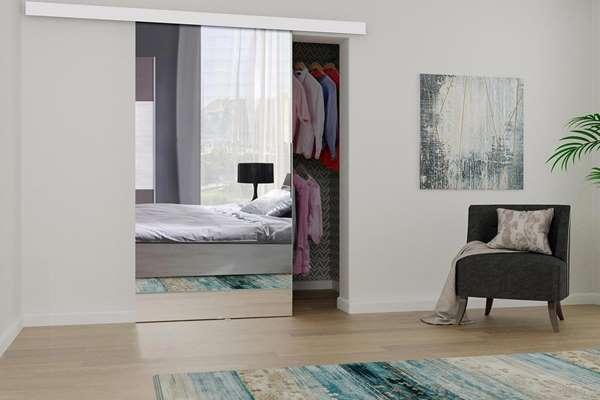 Drzwi przesuwne - sposób na praktyczną garderobę.